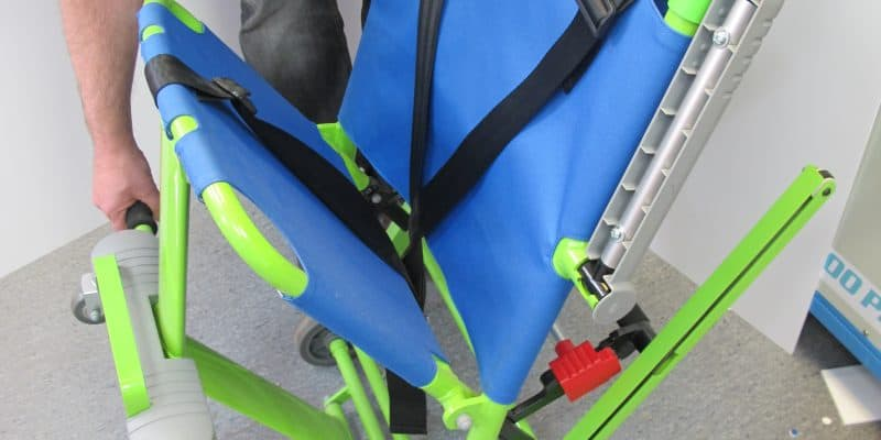 Evacuation chair being opened for servicing