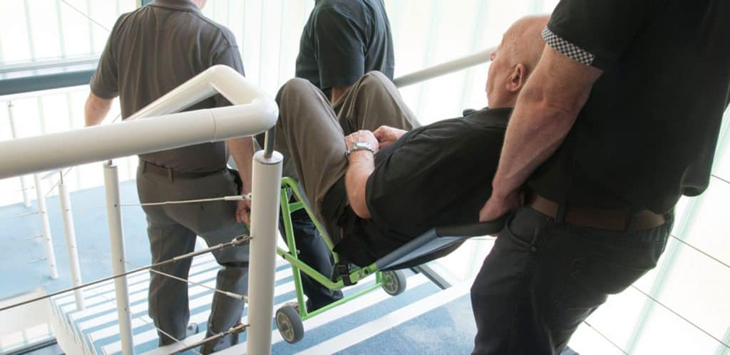An example of how Transit Wheelchairs can be used to carry a patient downstairs