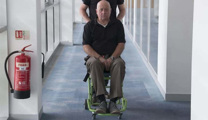 Evacusafe transit chair being used to transfer patient across a level floor