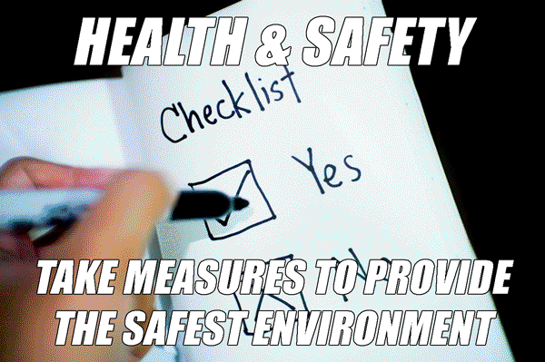 A man holding a health and safety checklist