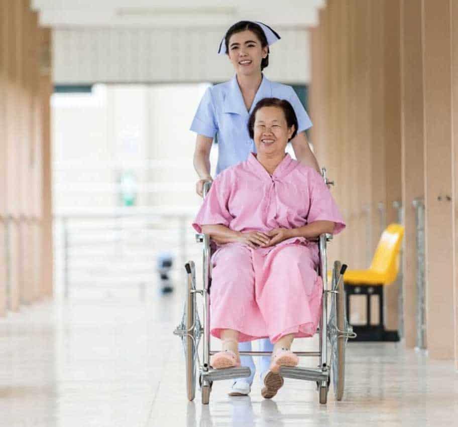 nurse-pushing-patient-in-transit-chair